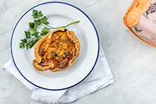 Burford Brown Mushroom Quiche on white plate with decorative parsley